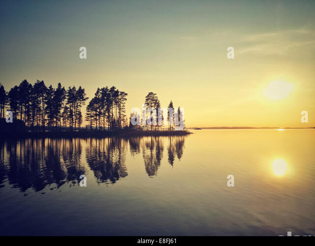 Sweden, Tallberg, Lake Siljan at sunset - Stock Image