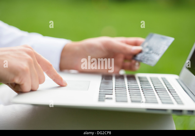 Female laptop finger table garden grass outdoor - Stock Image