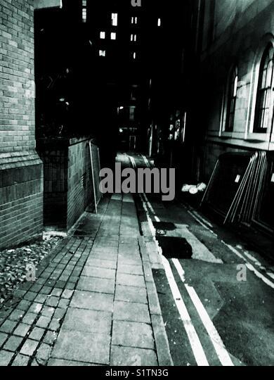 Dark alley back street in Manchester UK - Stock Image