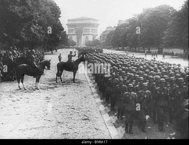The Hitler troops in the streets of Paris in The Great Victory of the Soviet People documentary - Stock Image