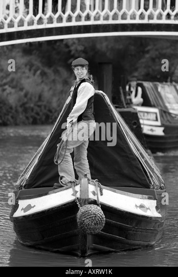 B&W taditional FMC narrowboat & butty on the Grand Union Canal - Stock Image