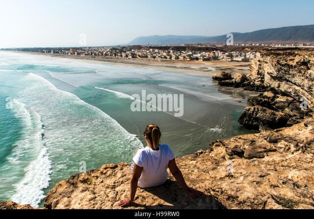girl coastside view Taqah plateau City Salalah Dhofar Sultanate of Oman 3 - Stock Image