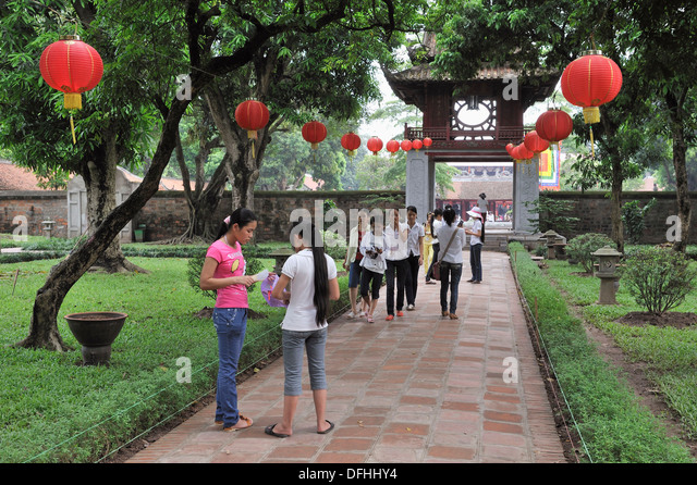 young girls visiting the Temple of Literature, Hanoi, Northern Vietnam, southeast asia - Stock Image