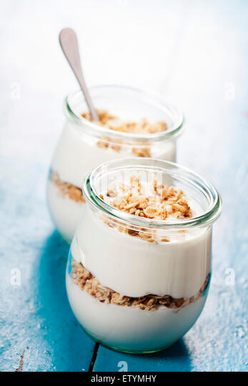 Healthy breakfast - yogurt with muesli - health and diet concept - Stock Image