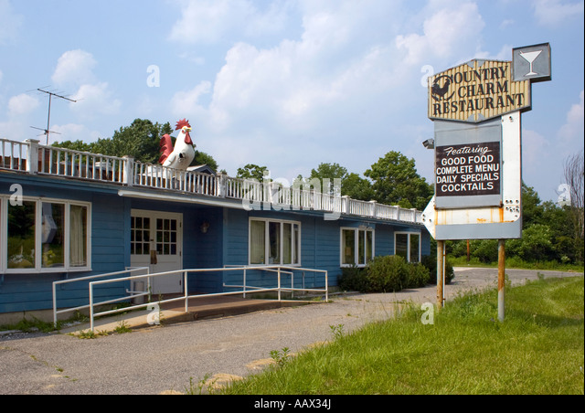 Rooster on the roof at the Country Charm Restaurant in Chesire Massachusetts - Stock Image