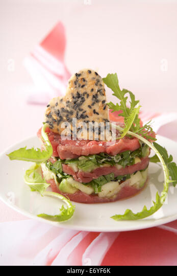 Beef carpaccio,Granny Smith and palm heart mille-feuille - Stock Image