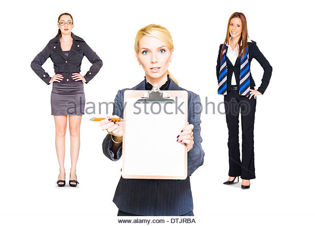 Studio Portrait Of A Team Of Three Business People Offering A Copyspace Clipboard With Contract To Sign In A Job - Stock Image