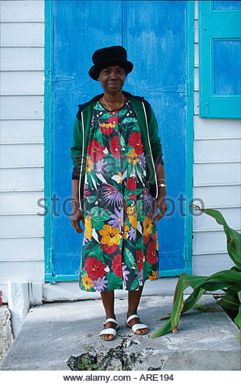 Bahamas Elbow Cay Hope Town Harbour Lodge Haitian woman in front of Butterfly House - Stock Image