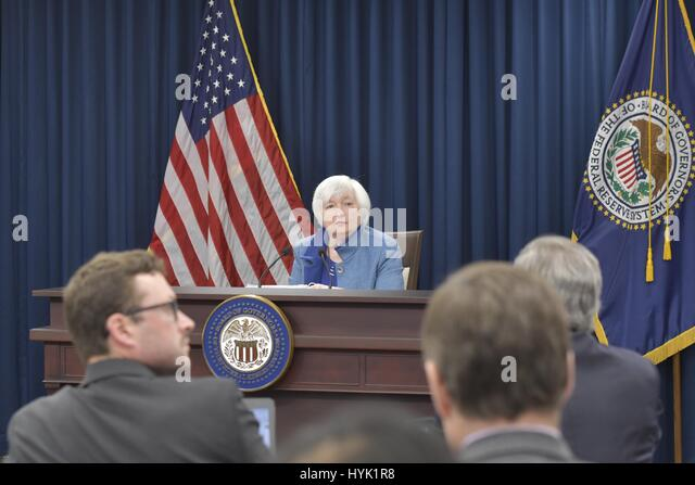 FOMC Chair Janet Yellen listens to a reporter's question during a press conference, December 14, 2016. - Stock Image