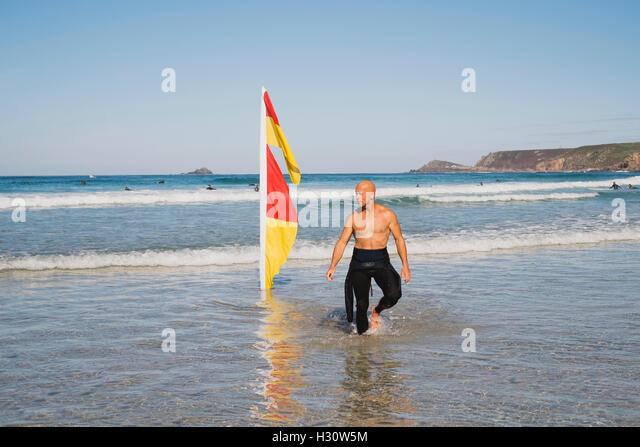 Sennen Cove, Cornwall, UK. 02nd Oct, 2016. Lifeguard on duty at Sennen Cove, Cornwall. 2nd October 2016. Credit: - Stock Image