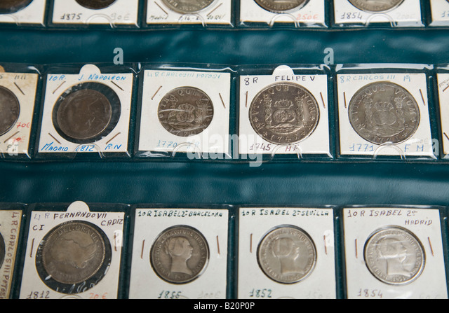 SPAIN Madrid Collection of Spanish coins from 1700 and 1800s displayed in pages with prices in euros for sale pesetas - Stock-Bilder