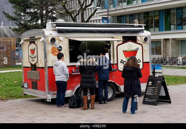 Students ordering lunch at an Asian food truck on the campus of the University of British Columbia, Vancouver, Canada - Stock Image