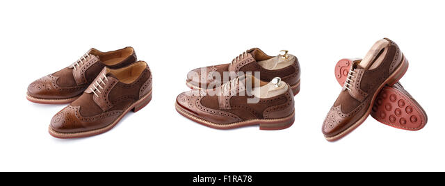 Set of two tone brown suede brogues (also known as derbies,gibsons or wingtips) on thick welted red rubber sole. - Stock Image