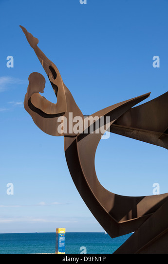 Athletic metal sculpture by Alfredo Lanz on the promenade at Barceloneta, Barcelona, Catalunya, Spain - Stock Image