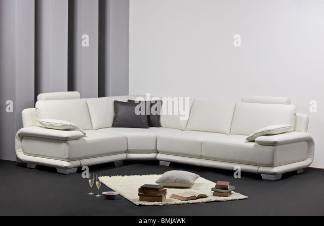 A modern minimalist living-room with white furniture - Stock Image