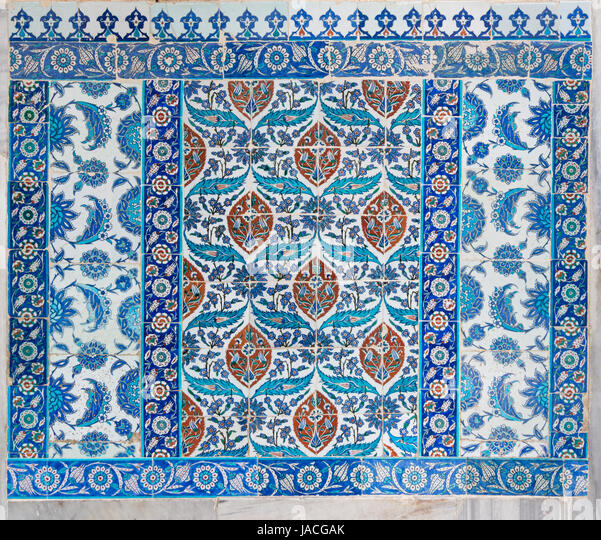 Old ceramic wall tiles with floral blue pattern in an exterior wall of the historic Eyup Sultan Mosque situated - Stock Image