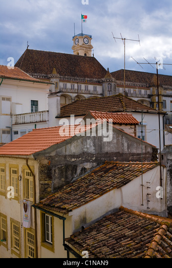 Baroque Tower aka Torre of University, above rooftops of Coimbra, Portugal - Stock-Bilder