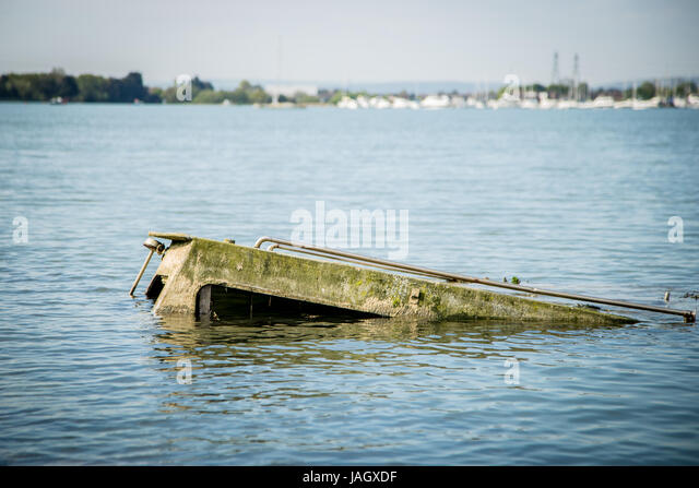 Submerged boat stock photos submerged boat stock images for Rocky waters motor inn fire damage