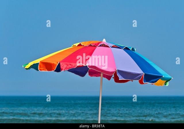 Colorful beach umbrella. - Stock Image