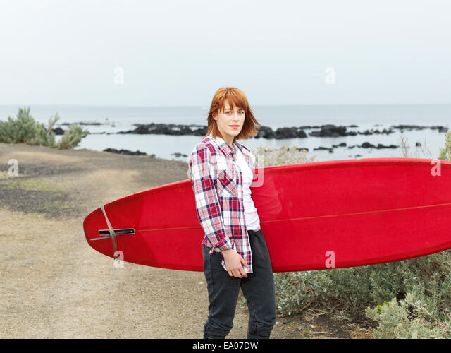 Female surfer with longboard surfboard, Williamstown beach, Melbourne, Australia - Stock-Bilder