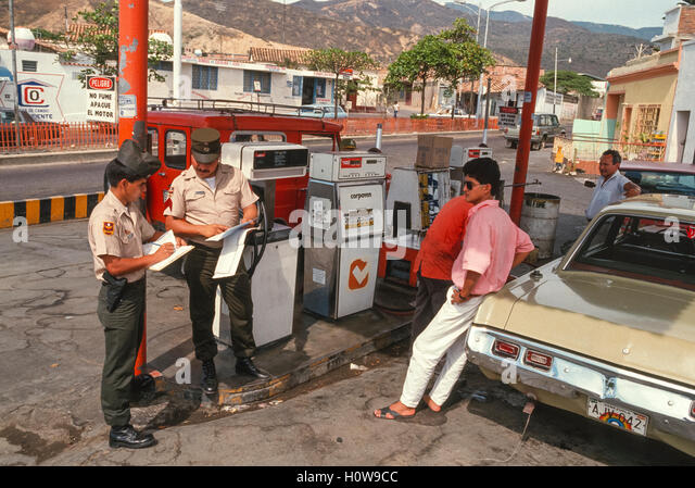 SAN ANTONIO, TACHIRA STATE, VENEZUELA - National Guard soldiers check vehicles at gas station. Fuel is smuggled - Stock Image