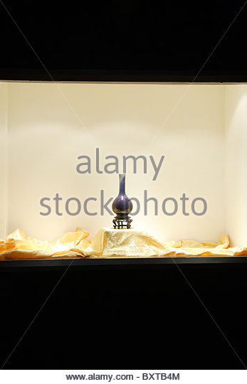 The antique behind the shopwindow - Stock Image