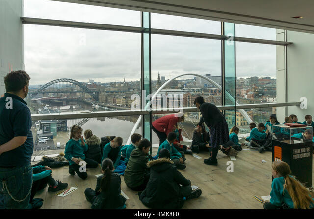 Schoolchildren enjoying the view from the Viewing Box on the 4th floor of the Baltic Centre for Contemporary Art - Stock Image