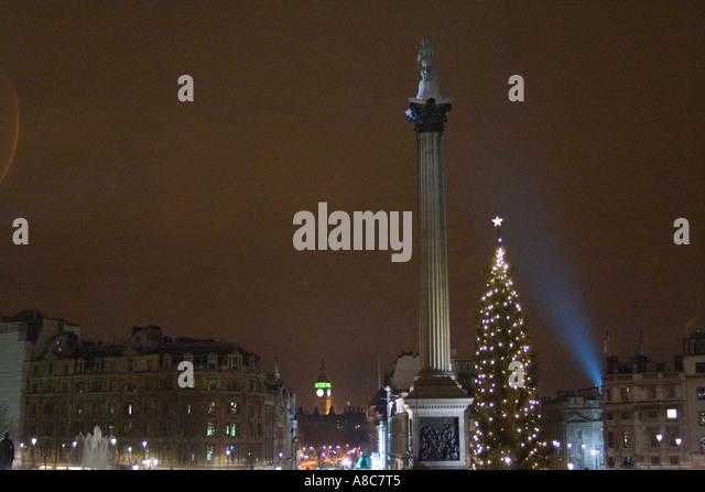 Trafalgar Square at Night Christmas time London England Big Ben in Background - Stock Image