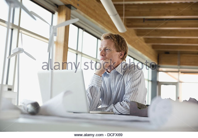 Sustainable energy engineer daydreaming - Stock Image