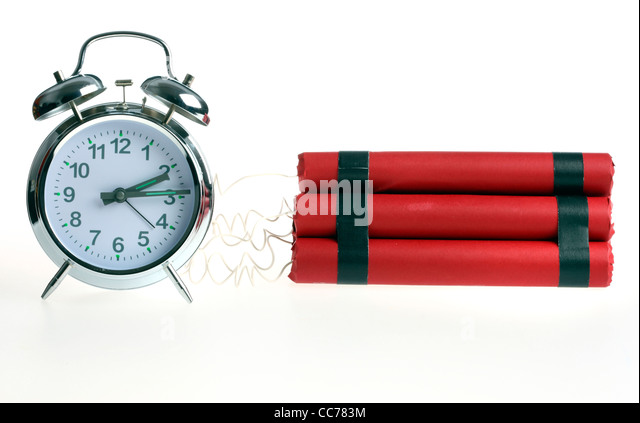 Symbol picture, time bomb. Bomb, explosive charge, crime, terrorism. Released by an alarm clock, timer. - Stock Image