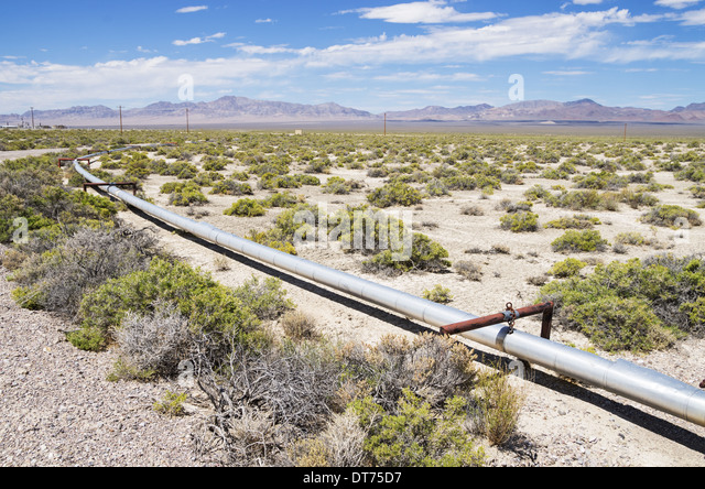 small oil pipeline in the desert in New Mexico - Stock Image