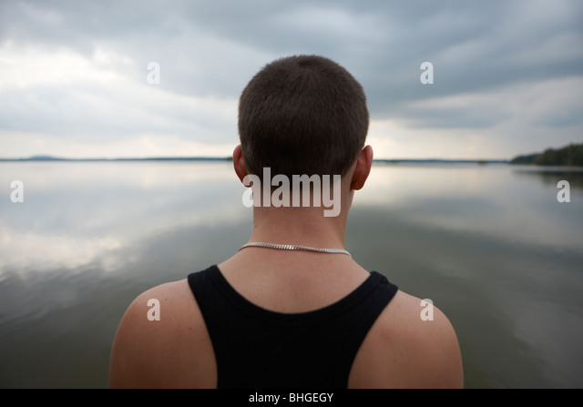 Boy looking at the horizon, Sweden. - Stock Image