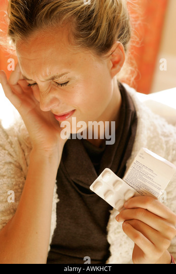 woman with headache and paracetamol - Stock Image