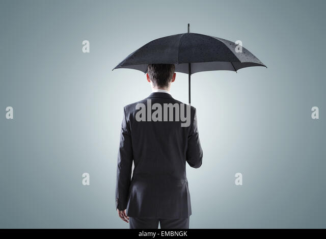 Conceptual picture of the depressed businessman - Stock Image