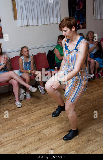At the Maverick music festival a young woman demonstrates step dancing - Stock Image