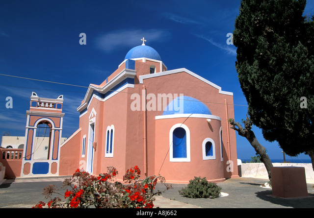 Greece Santorini Church with blue dome and pink structure - Stock Image