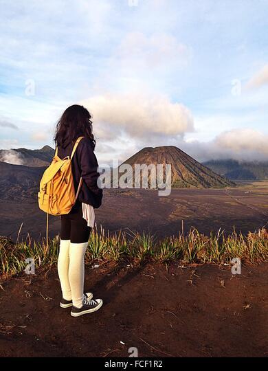 Woman Looking At Volcano - Stock Image