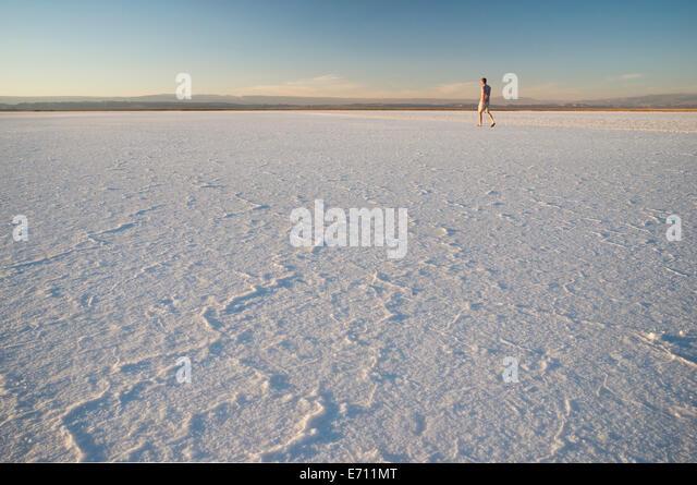 Man walking, Laguna Salada, Salar de Atacama, El Norte Grande, Chile - Stock Image
