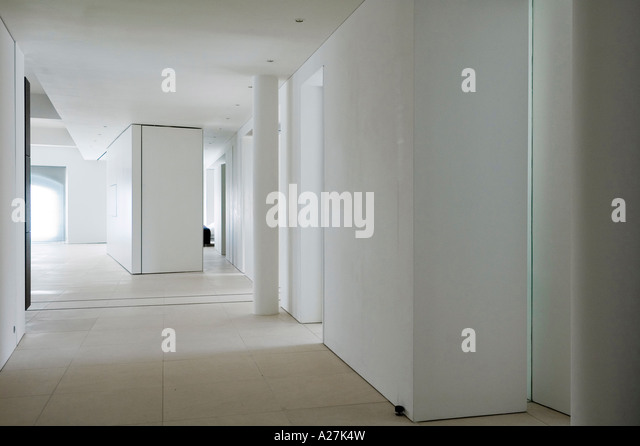 Hallway in minimalist warehouse conversion - Stock Image