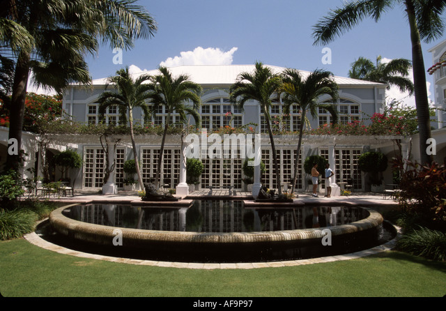 Grand Cayman BWI Hyatt Regency Hotel British Colonial style architecture reflecting pool - Stock Image