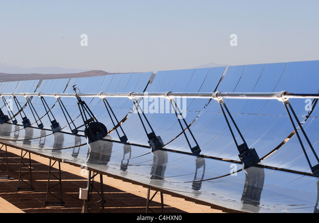 SEGS solar thermal energy electricity plant with parabolic mirrors concentrating the sunlight - Stock Image