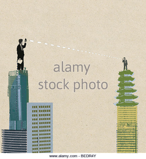 Businesspeople communicating from highrise rooftop - Stock Image