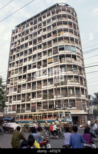 Vietnam Saigon Ho Chi Minh City traffic bicycles public bus residential apartment building - Stock Image