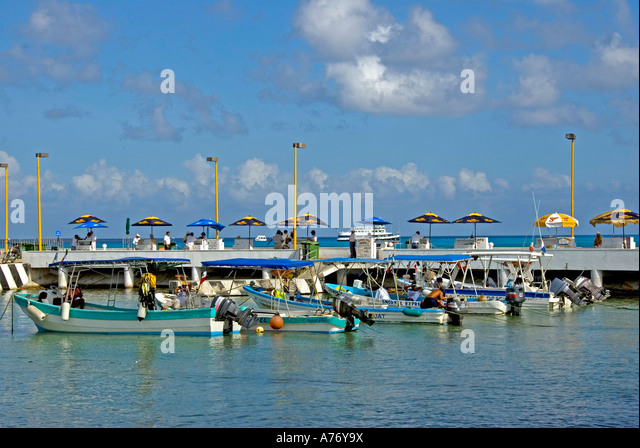 Cozumel Mexico San Miguel town malecon harbour fishing tour boats ferry pier - Stock Image