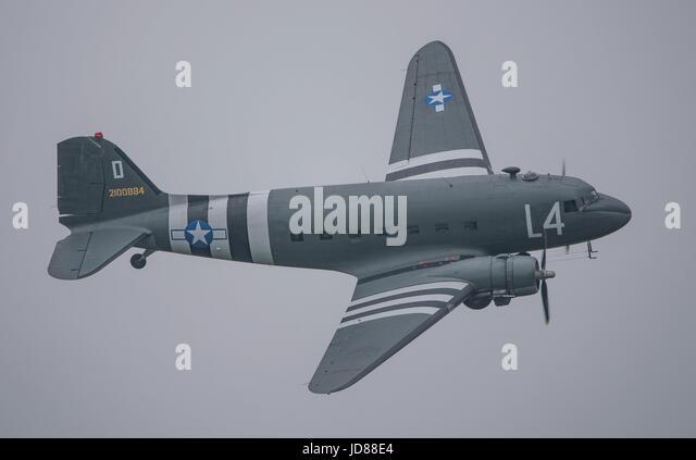 Douglas C-47 Skytrain (DC-3 Dakota) against a grey sky at Dunsfold Airshow. - Stock Image