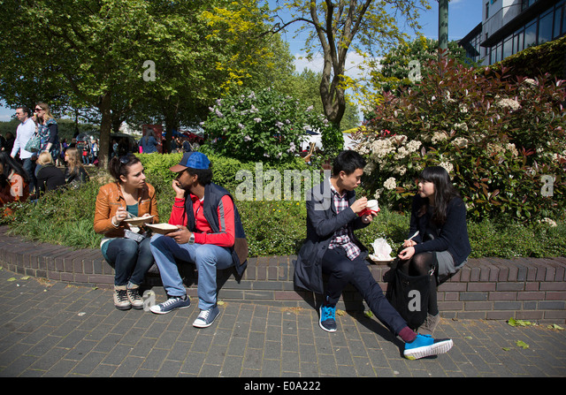 Friends eating ice cream during a food festival on the Southbank. South Bank is a significant arts and entertainment - Stock Image