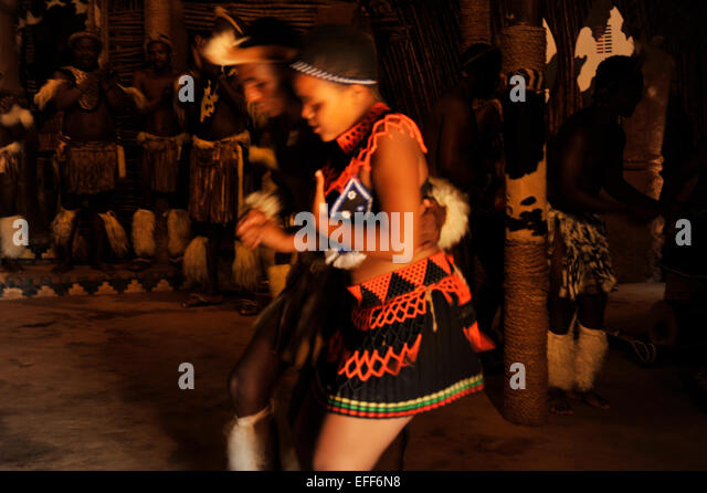 Man and woman dancing couple perform traditional dance at Zulu culture village Shakaland South Africa Travel Cultures - Stock-Bilder