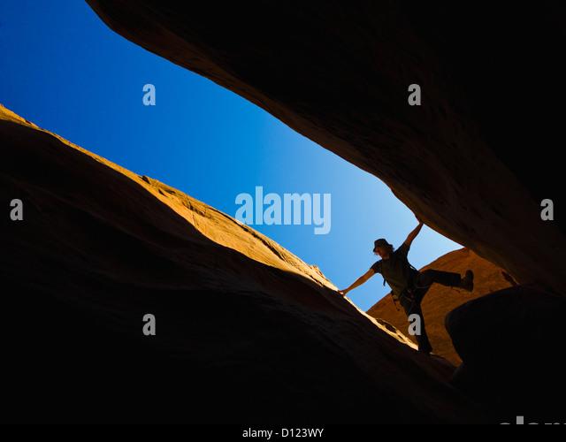 A Male Athlete Exploring Utah Slot Canyons; Hanksville Utah United States Of America - Stock Image