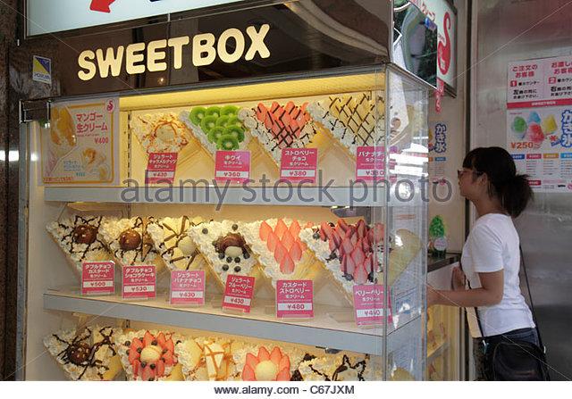Japan Tokyo Harajuku Takeshita Dori Street shopping shoppers kanji hiragana characters Japanese and English Sweetbox - Stock Image