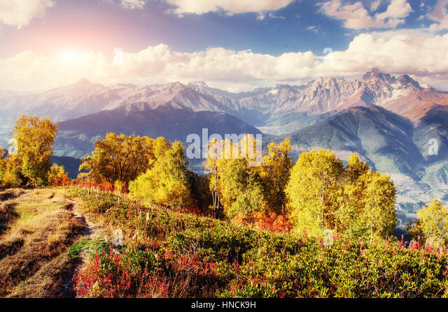 Autumn landscape and snow-capped mountain peaks. View of the mou - Stock Image